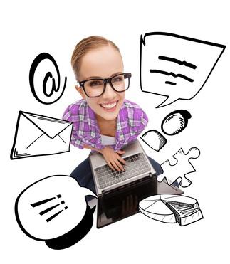 smiling teenage girl in eyeglasses with laptop